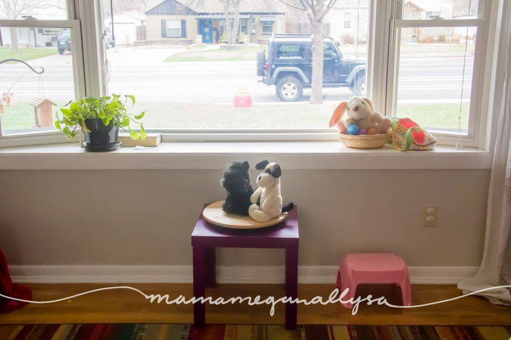 Our large window with her play table under it and her discovery tray on the ledge