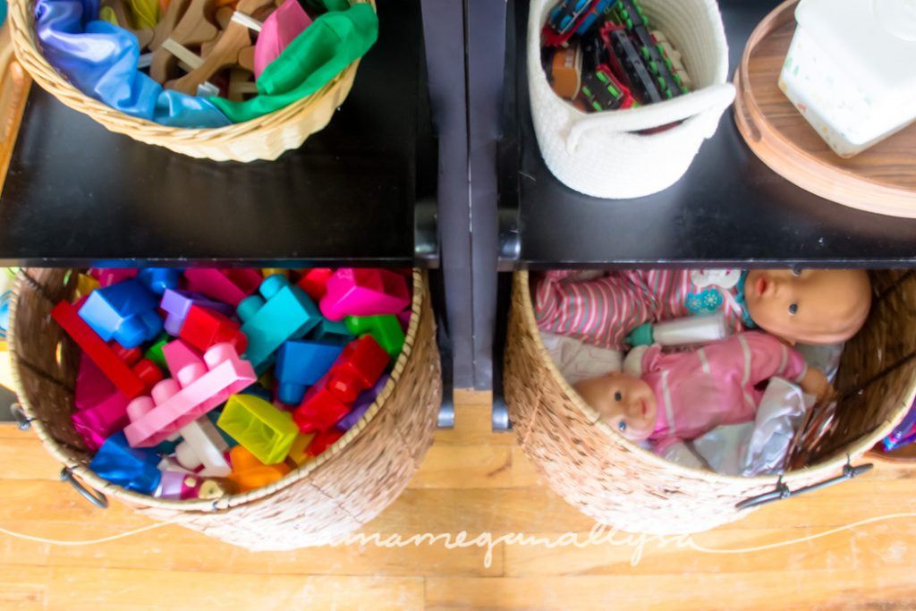 Our big baskets with her building blocks and baby dolls
