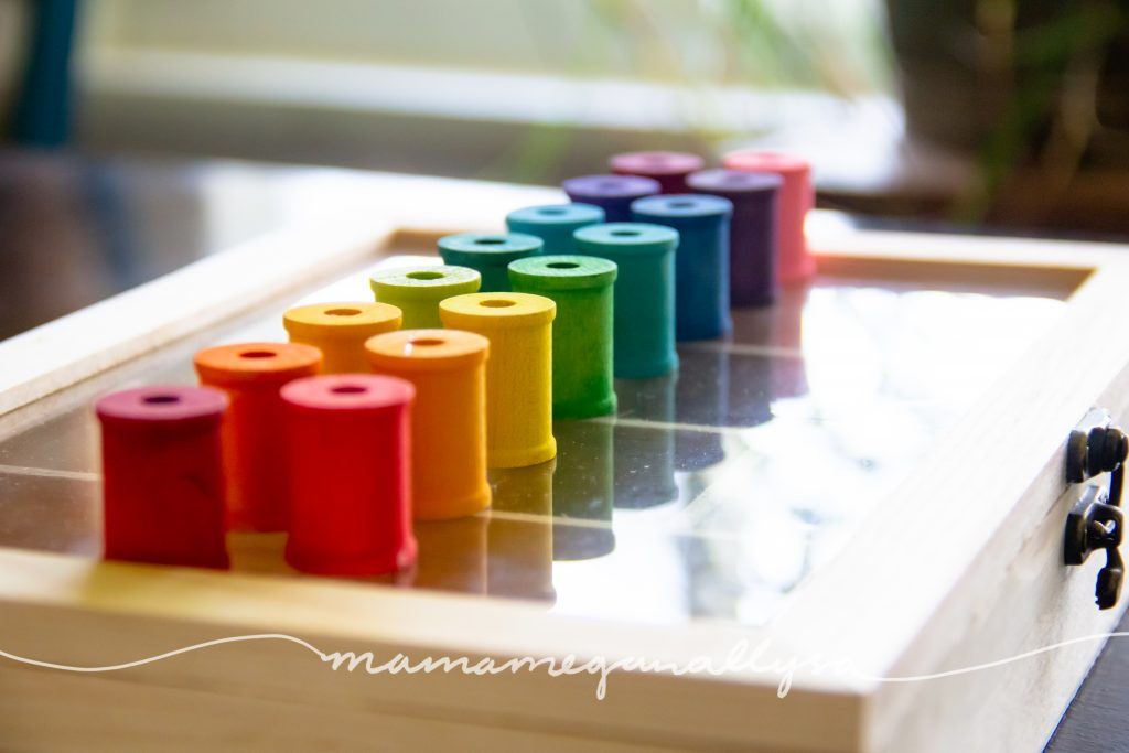rainbow hand-painted wooden spools for loose parts play