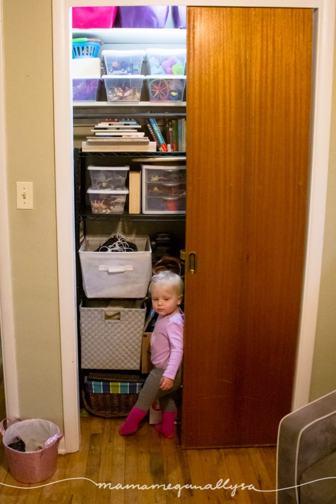 a toddler getting into her toy closet