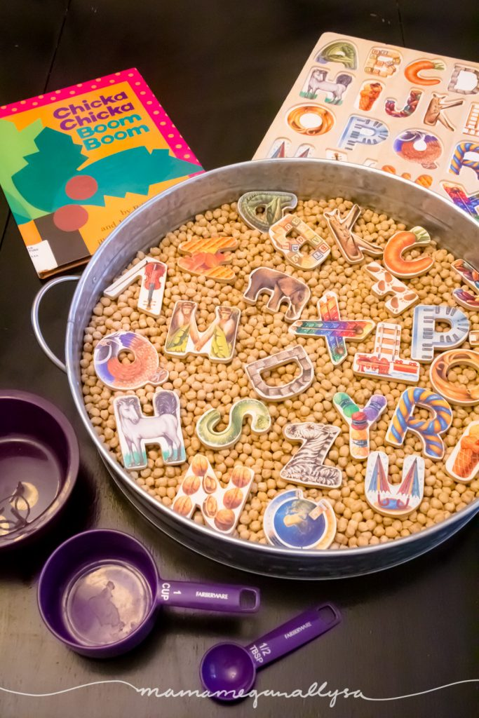 an overview of the ABC's and Chick peas sensory bin, puzzle pieces, the purple bowls and spoon, Chicka Chikca Boom Boom book and the puzzle tray