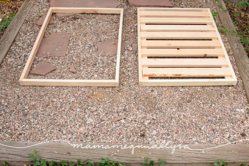 completed top frame and bottom shelf for the DIY sensory bin table laying on the ground