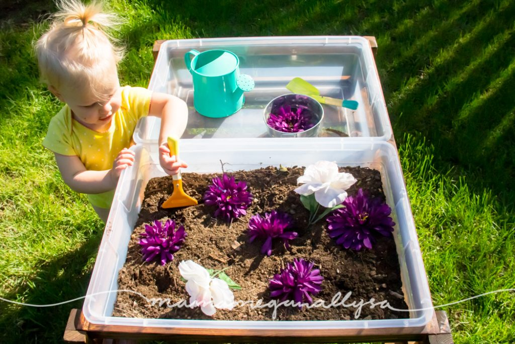 a top down view showing our duel bin system for our DIY sensory bin table