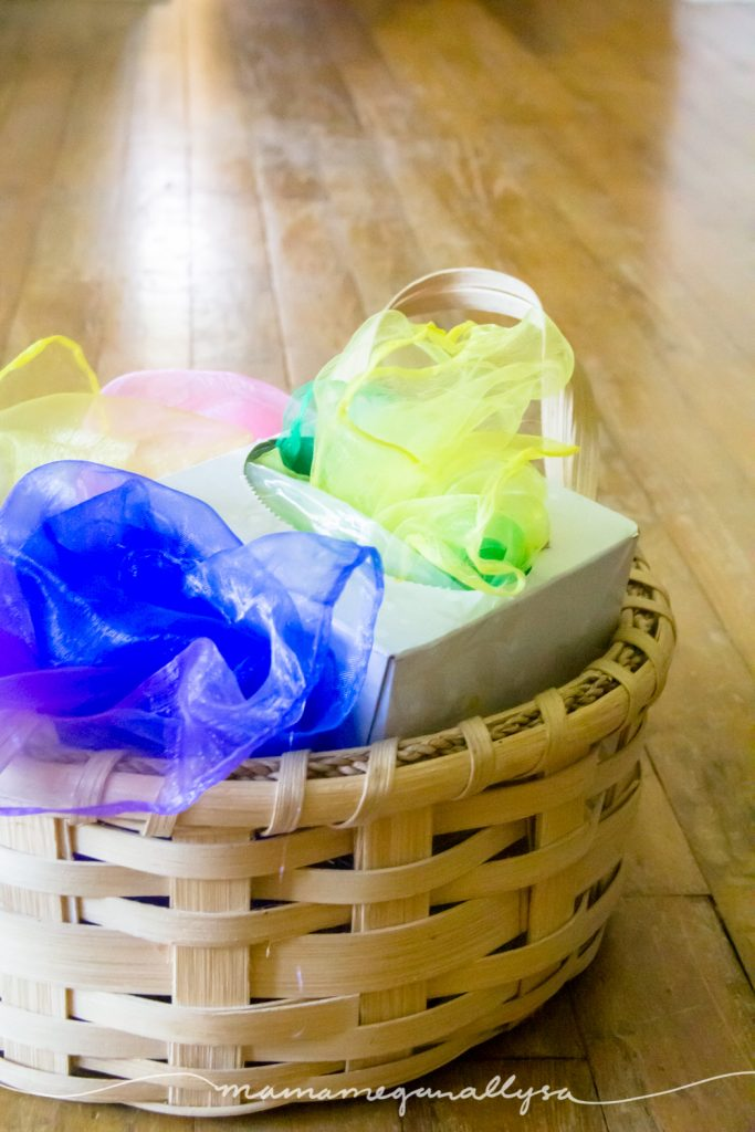basket of dance scarves and a kleenex box for free play