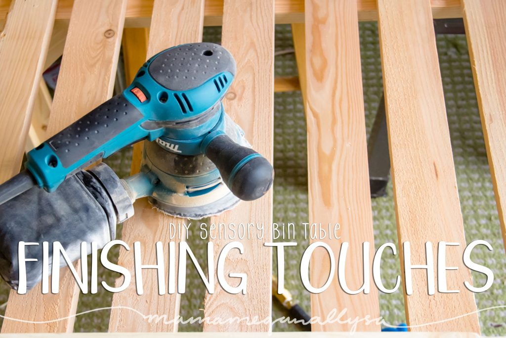 title card for the finishing touches of our DIY sensory bin table showing a power sander sitting on the slats of the table