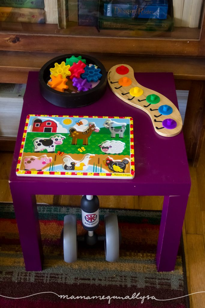 a small table with two puzzles on it in our play space