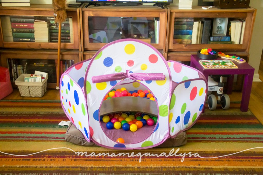 a ball pit in the middle of the living room