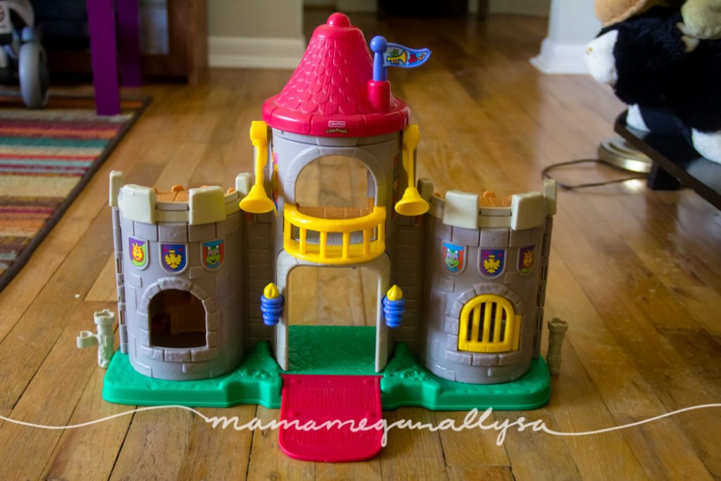 Her favortie toy this week ; a Little People Castle and Rapunzel Little People Figures