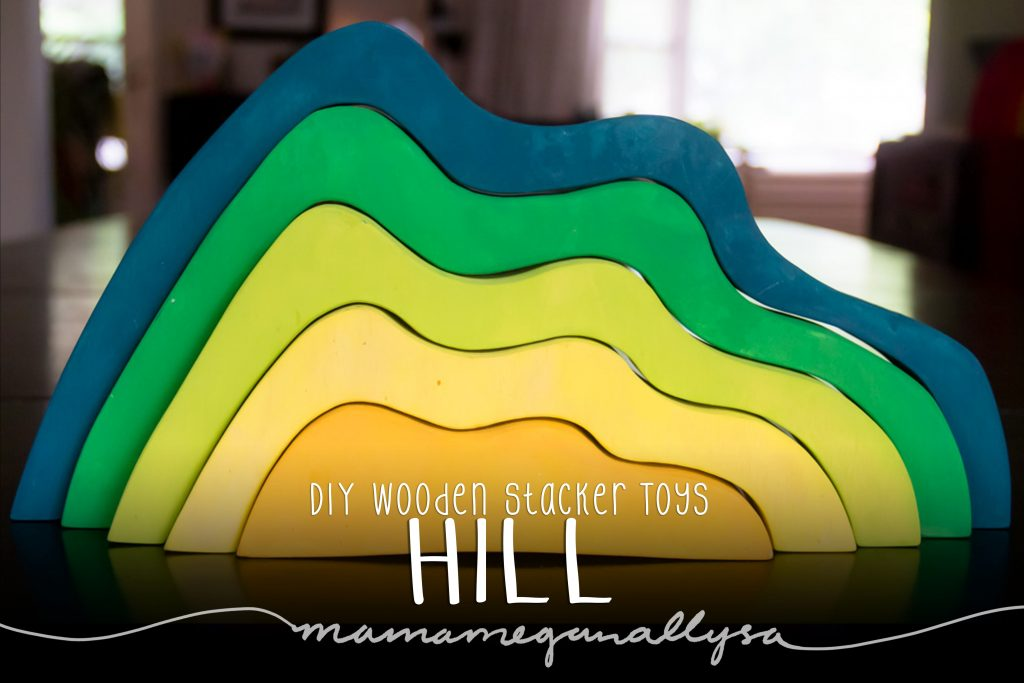DIY stacker Toys : The Hill painted in  a gradient from a rich yellow at the center to a deep green blue on the outer band