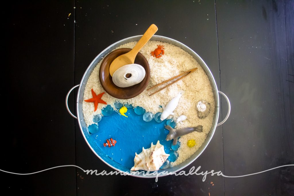 I pulled our beach themed rice sensory bin together using all items that we already owned