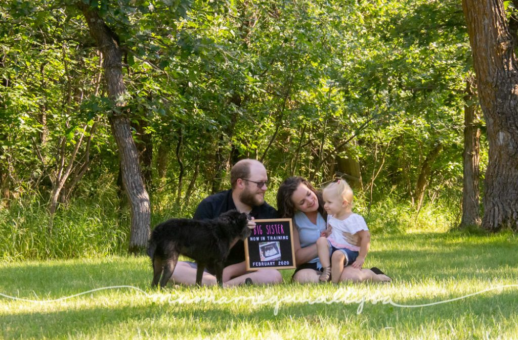 Pregnancy announcement with our daughter and dog