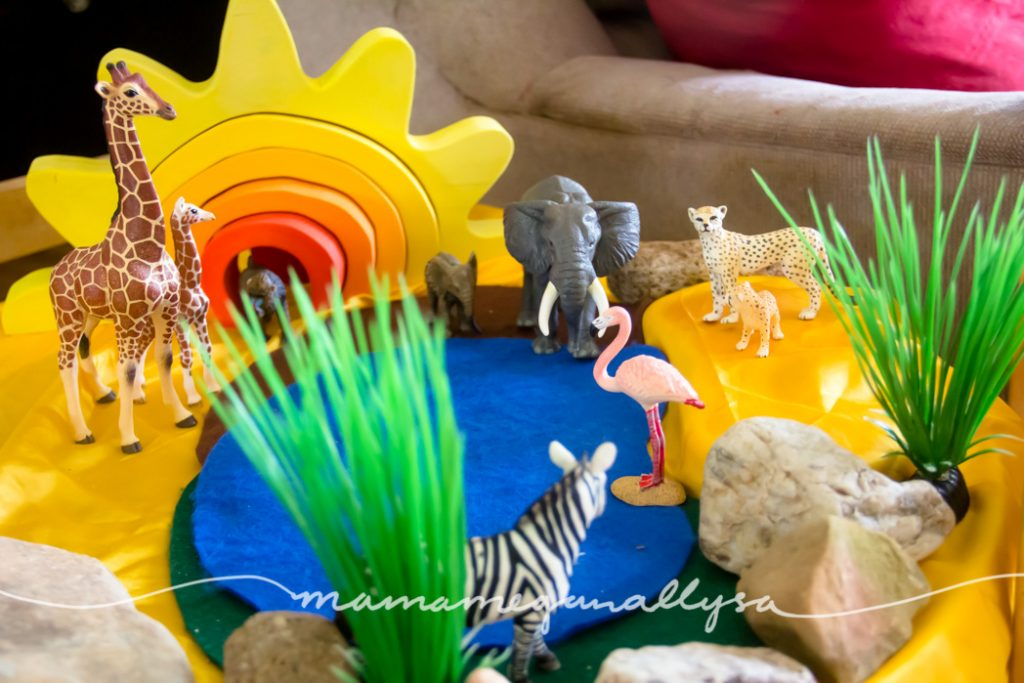 She has loved matching mama and baby with our plastic animals this week on our African savanna small world