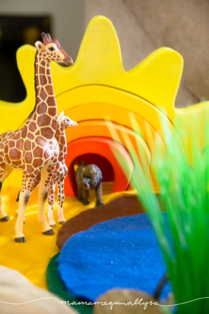 our homemade sun stacker  toy makes a great backdrop for our African Savanna small world set up
