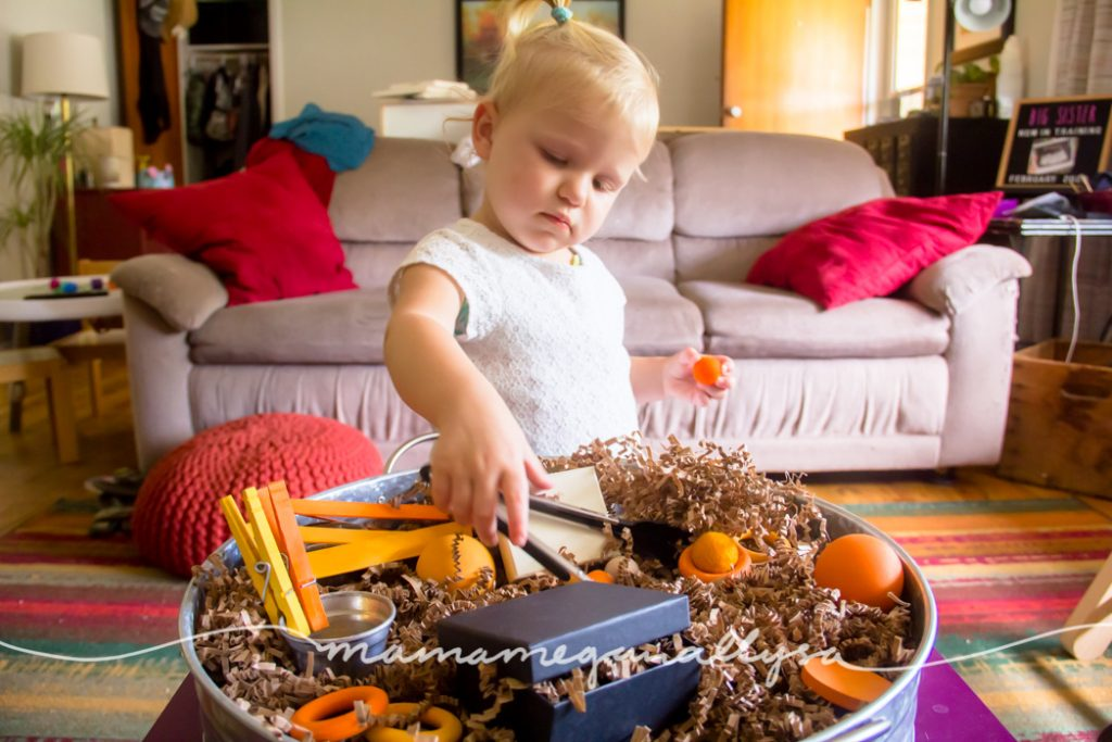 The Orange Loose Parts sensory bin is simple and still offers lots of varied play opportunity!