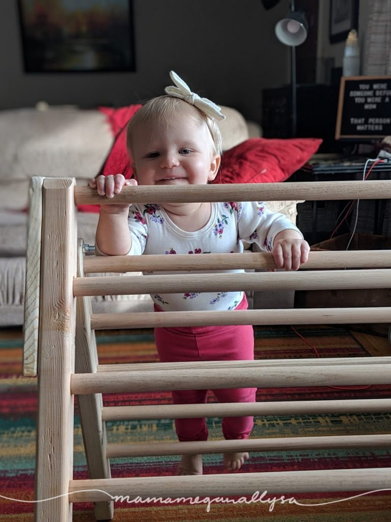 With out a doubt the Pikler triangle is my number one 1-year-old must-have toys. I could go on forever the ways that she plays with this simple wooden climbing structure.