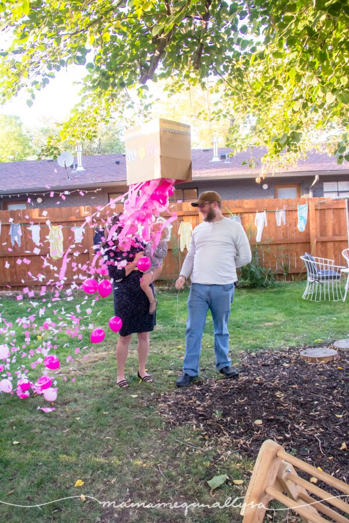 pink streams, balloons and confetti falling out of our gender reveal box