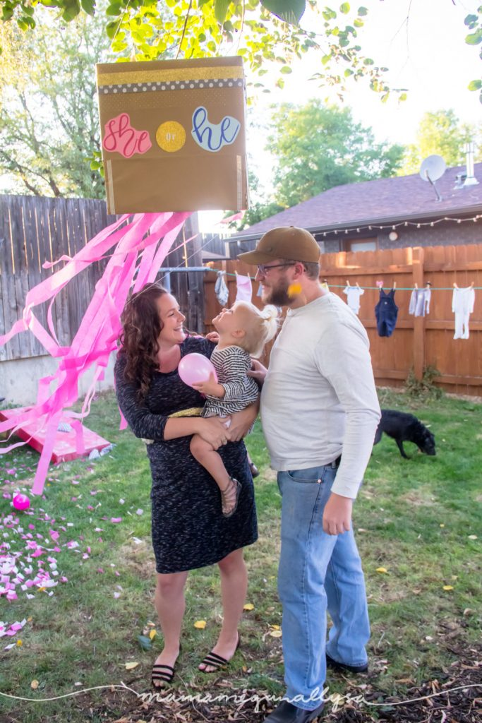 Our sweet family (even photobombed by our dog) after we opened our gender reveal box for baby number 2