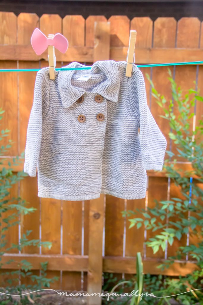 a close up of my current favorite baby piece, a grey chunk knit cardigan