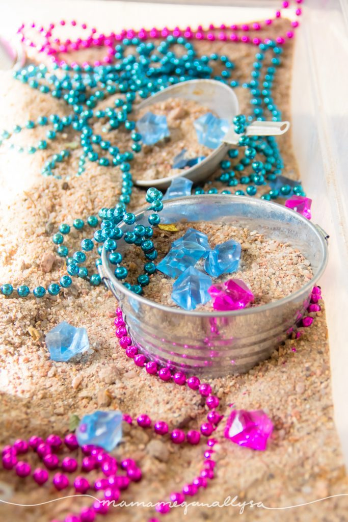 The pink and blue treasures we included in our gender reveal sensory bin were bead necklaces and aquarium gems