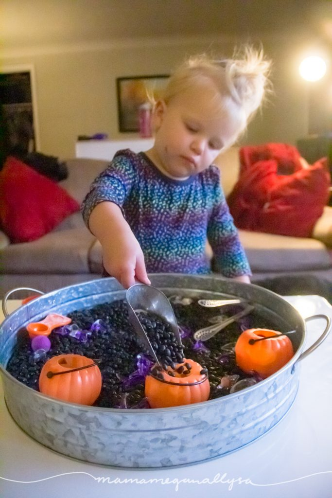 A candy jar scoop is our favorite sensory bin tool for scooping and pouring