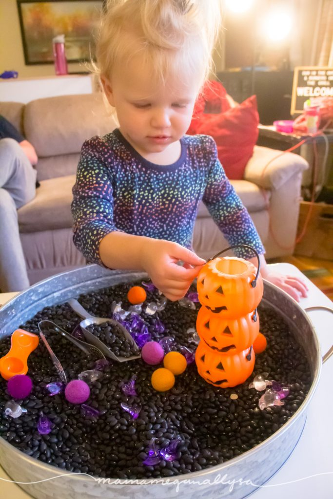 Holiday decorations and part favors make for great additions to our Halloween sensory bin.