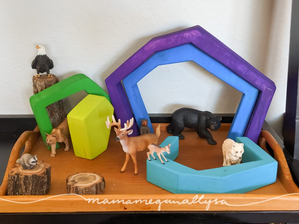 A forest scene set up with some animal figures and our DIY cave stacker.
