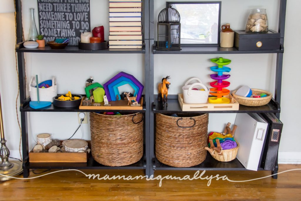We display our free play toys on trays and low baskets. That way it is easy for her to see and we avoid the out of sight out of mind problem!