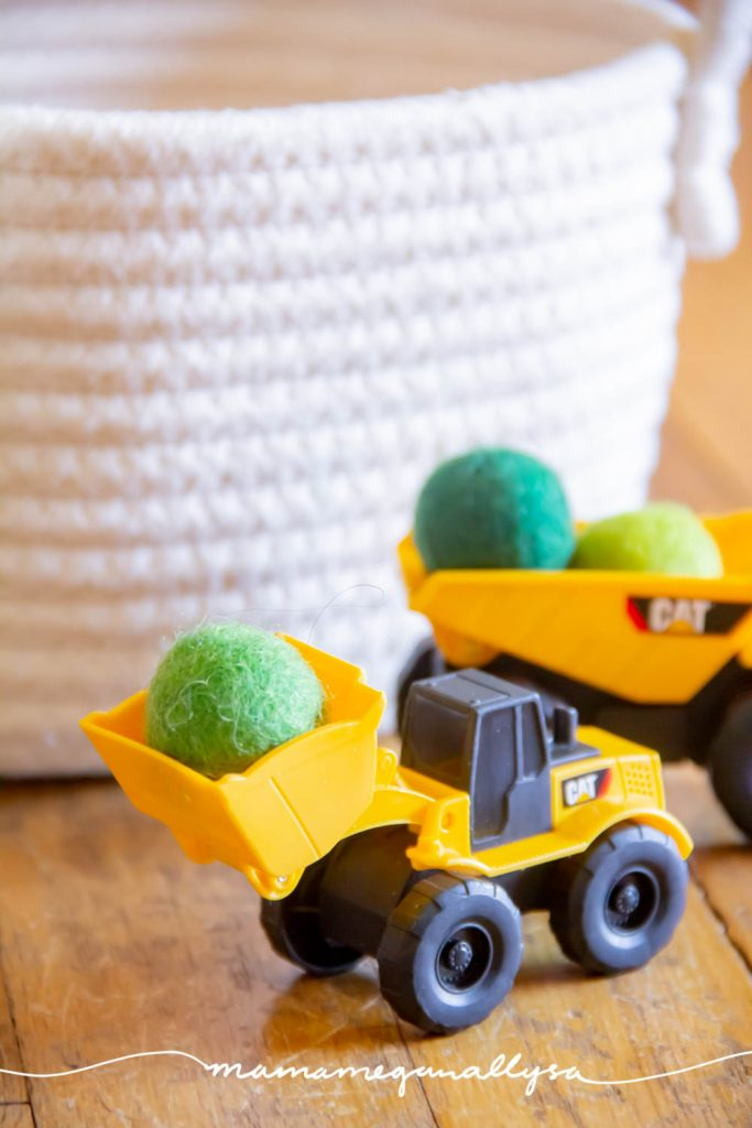"""I added some green wool balls to our mini construction trucks so that they would have some """"boulders"""" to work with"""