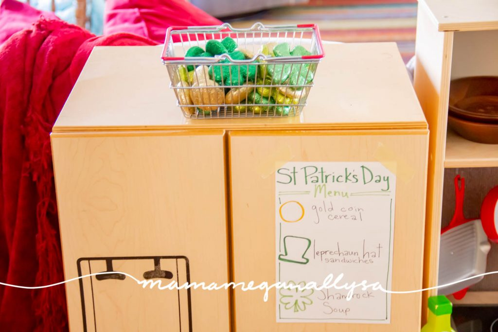 Part of our St. Patrick's Day Toy Rotation is a St. Patricks day menu and some decor used as loose parts for cooking in her play kitchen