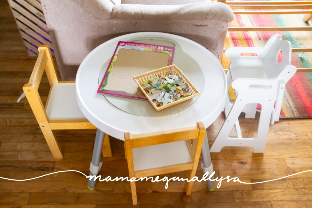 We keep our play table at the end of the couch she will sit there to color, play play dough, and serve her baby dolls food. I keep a puzzle there but it get moved out of the way a lot.