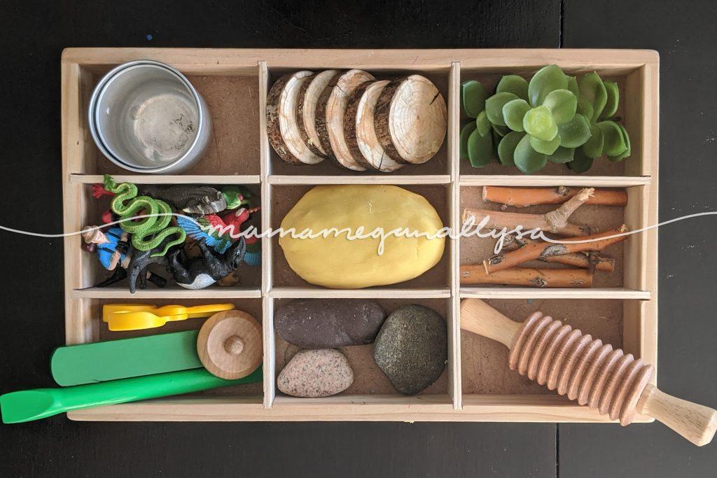 a jungle habitat themed play dough tray