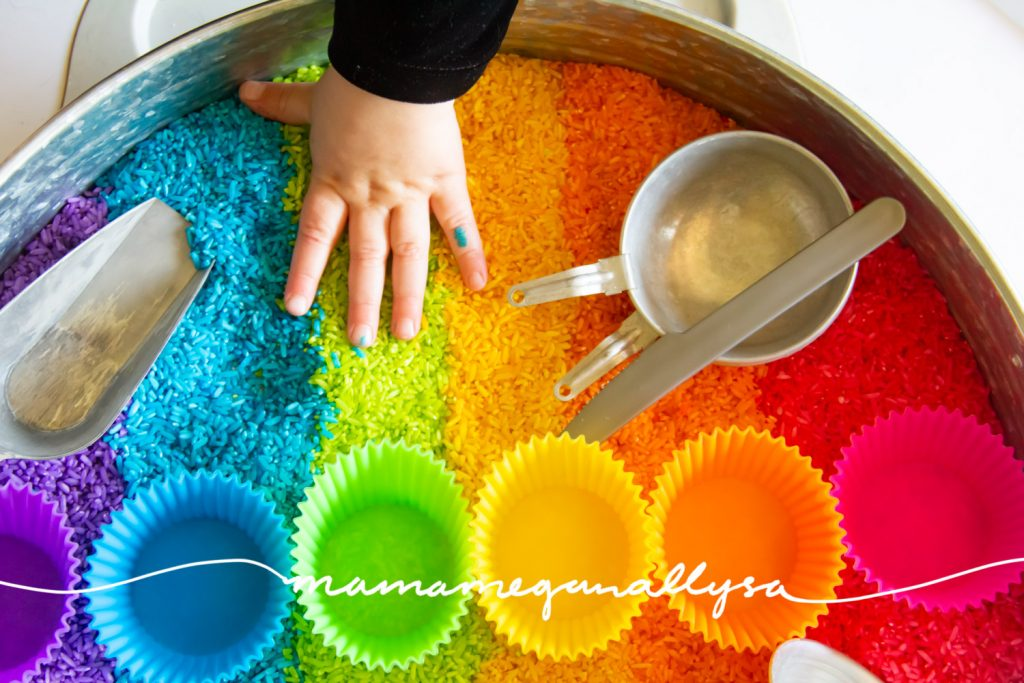 Rainbow rice is so beautiful that its hard for  kids to keep their hands out of it!