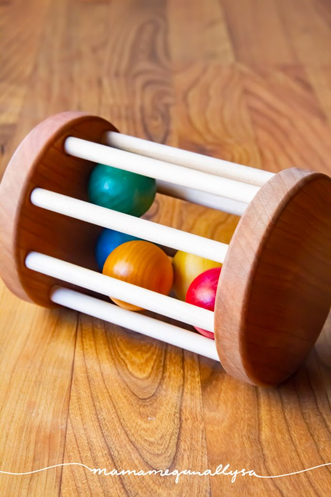 a classic Montessori wooden baby toy that promotes tummy time and crawling.