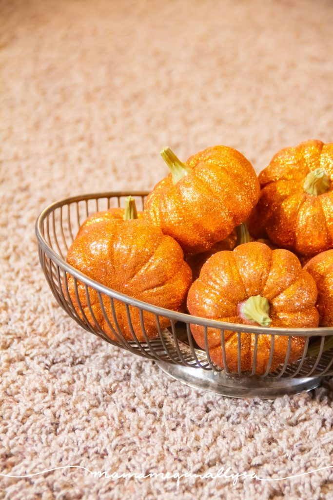 glitter pumpkins as both decor and loose parts play for both girls