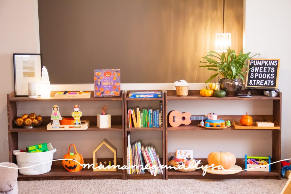 our custom build toy shelves are beautiful and just what I was looking for...except the baby now tries to pull everything off the shelves...so we may have to rethink the layout of this room...