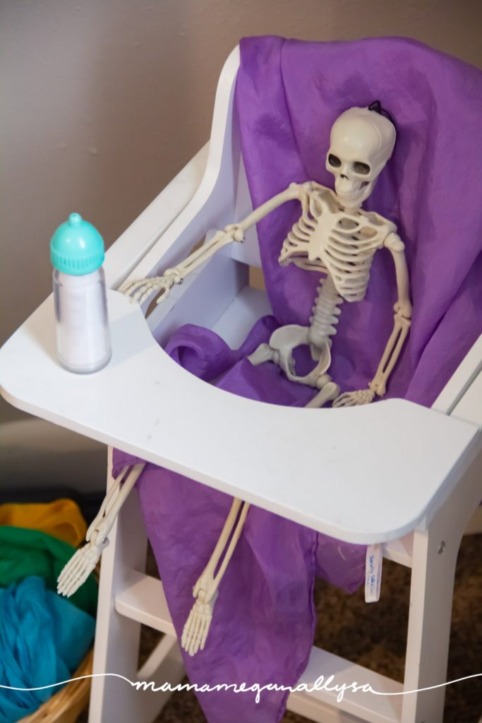 I replace the baby dolls in favor of a little skeleton and it has been a hoot watching them play this week!
