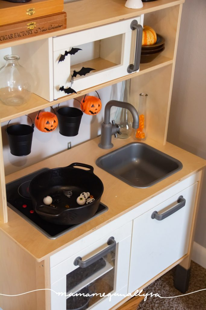 With a few decorations, some spooky loose parts, and a black cauldron to mix it all up in; our Witch's Kitchen is the perfect invitation to play for our Halloween toy rotation. We have been mixing up potions all day and it's a great way to incorporate loose parts into your play!