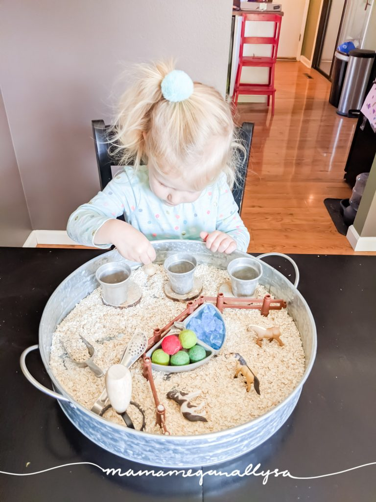 Allowing your child to explore however they see fit is what a good sensory bin is all about! Some kids stay super neat and clean others dive in fingers first and experience it all.