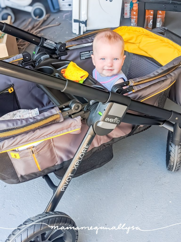 a baby sitting in a brand new stroller wagon