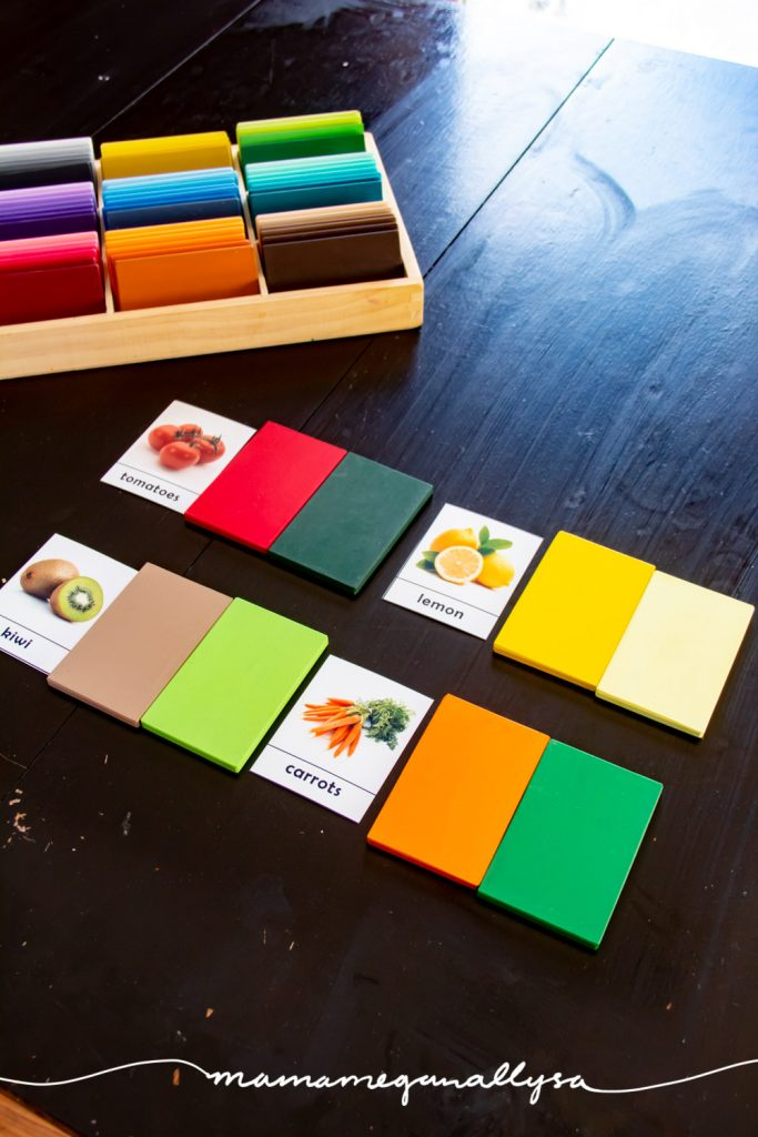 4 3-part-cards with a couple of color tablets next to each, showing the basic colors of the fruit and veggies depicted on the card. with the full set of color tablets in the background