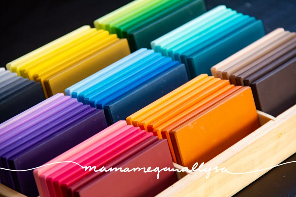 a close up of my DIY Montessori inspired color tablets stored in a wooden divided tray