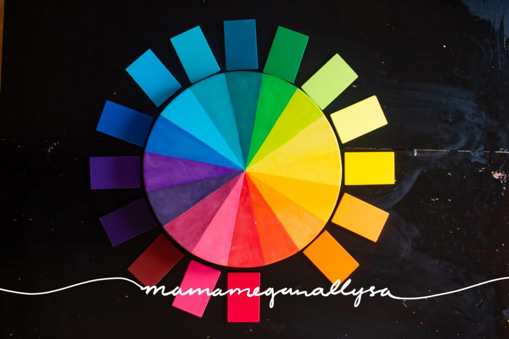 DIY wooden color wheel with color tablets laid around it to match up with the colors on the wheel