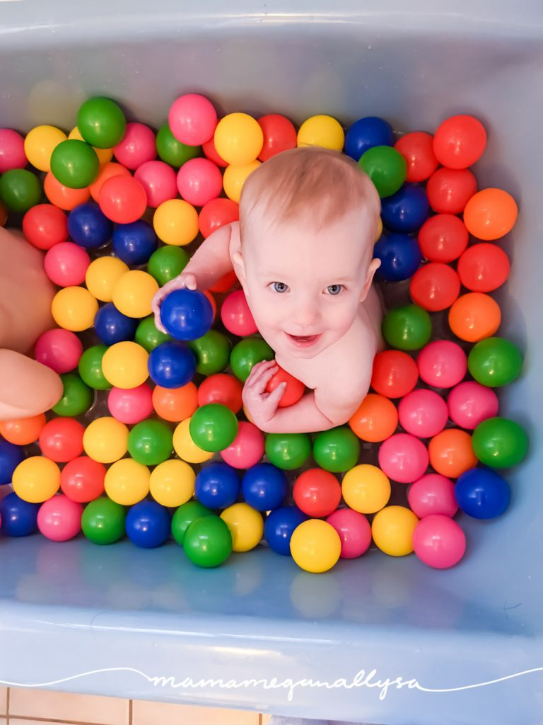a baby in a bathtub filled with ball bit balls