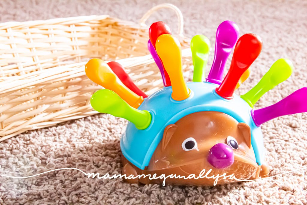 a close up of a plastic hedgehog with removable pegs on his back