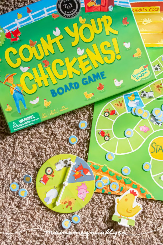 an top down shot of the board game count your chickens with the pieces scattered around it
