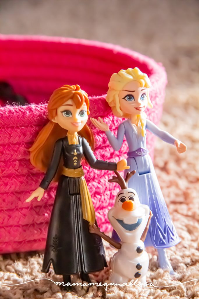 a close up shot of a small Anna, Elsa and Olaf figures from Frozen 2