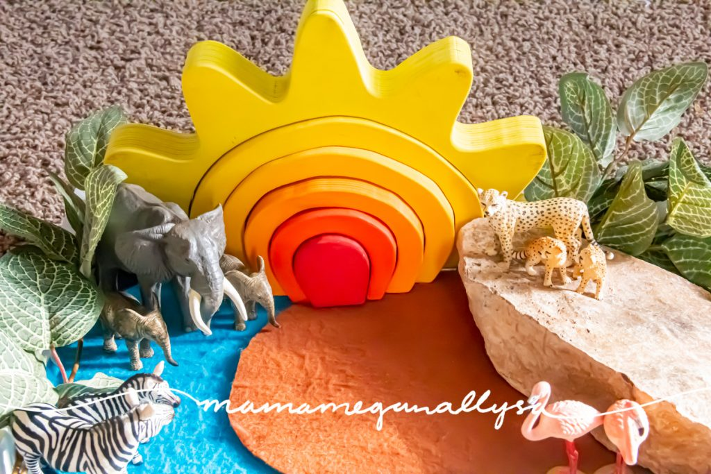 a detail shot of our safari small world with elephants, zebras, cheetahs, and flamingos with my DIY sun stacker