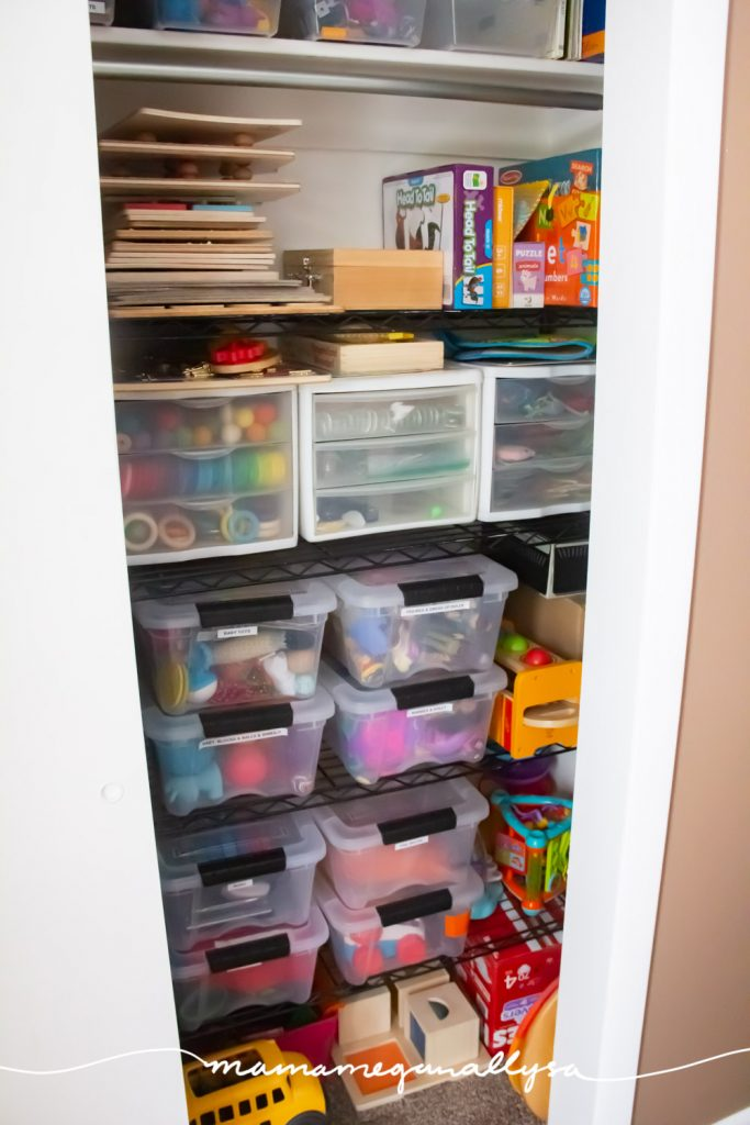 a toy storage closet with lots of bins on a wire shelf