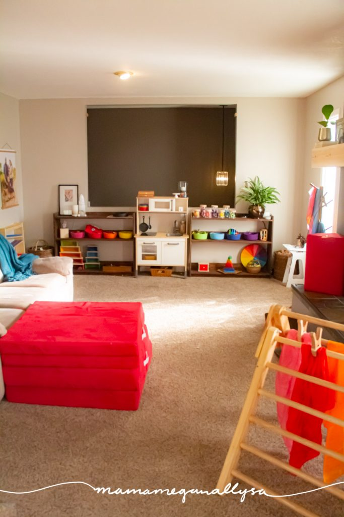 a overview shot of our rainbow toy rotation in our livingroom playroom