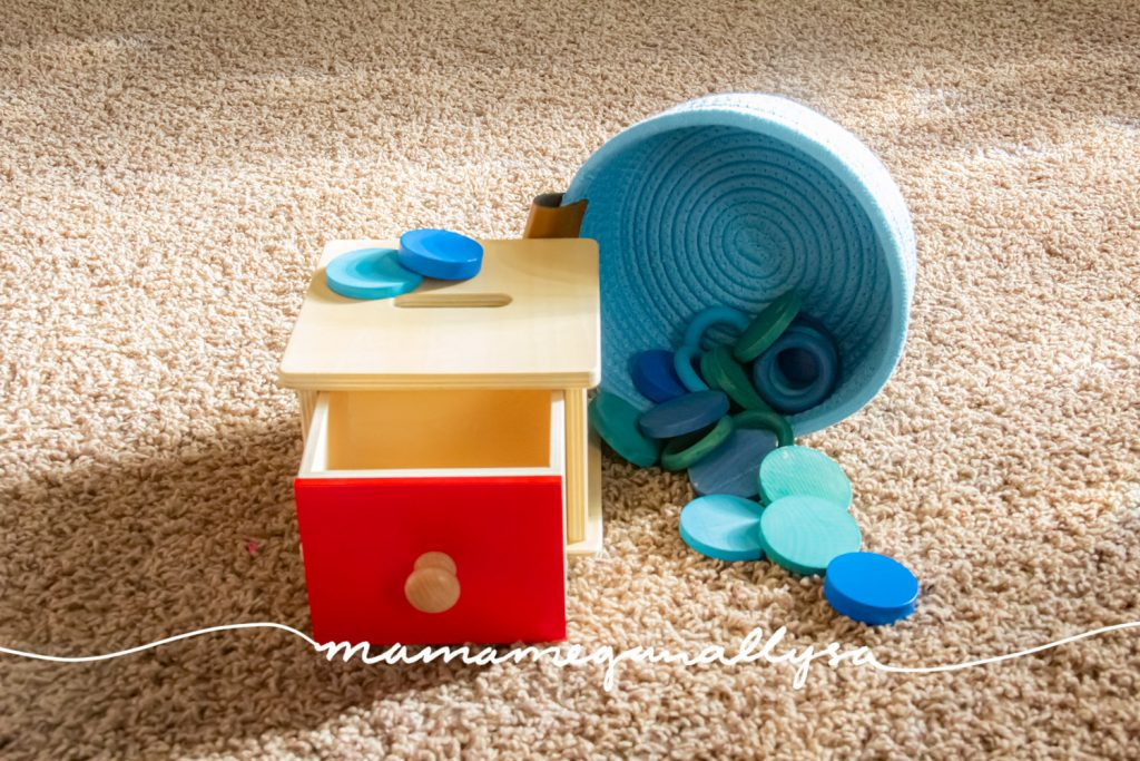 a light blue basket of blue rings and coins for our wooden coin box with red drawer